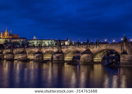 Castle and Charles Bridge by night in Prague, Czech Republic.