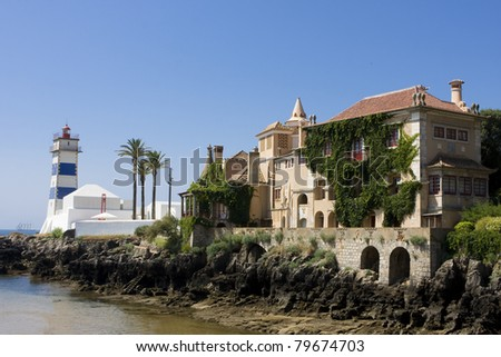 Castle and lighthouse near the sea in Cascais - Portugal
