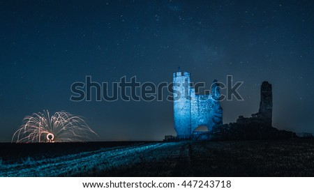 Castle caudilla night with fireworks and stars