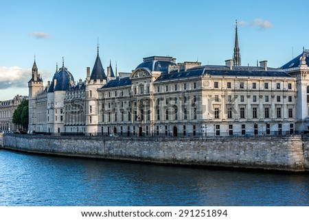 Castle Conciergerie - former royal palace and prison. Conciergerie located on the west of the Cite Island and today it is part of larger complex known as Palais de Justice. Paris, France. Sunset. - stock photo