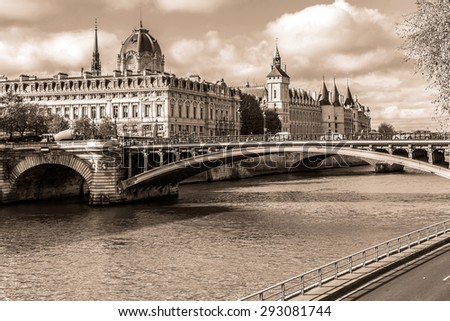 Castle Conciergerie - former royal palace and prison. Conciergerie located on west of the Cite Island and today it is part of larger complex known as Palais de Justice. Paris, France. Vintage.  - stock photo