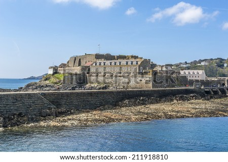 Castle Cornet has guarded Saint Peter Port for 800 years. Saint Peter Port - capital of Guernsey - British Crown dependency in English Channel off the coast of Normandy. View from English Channel.