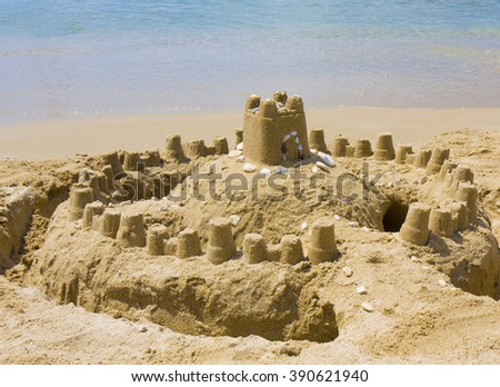 Castle from sand on beach near sea. - stock photo