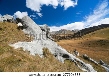 Castle Hill, Arthur's Pass National Park, New Zealand Beautiful landscape with gray stones and mountains on the background - stock photo