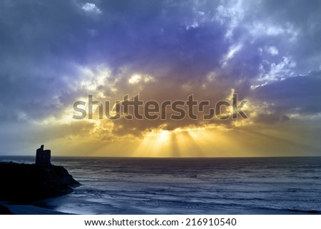 castle in Ballybunion county Kerry Ireland with beautiful beams shining through the clouds - stock photo
