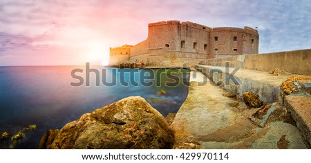 Castle in Dubrovnik during colorful sunset, Croatia - stock photo