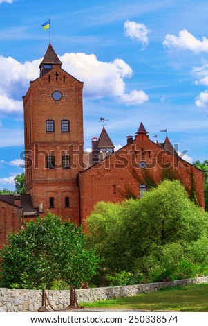 Castle in Radomyshl, Ukraine. One of the most popular places, also known for its collection of religious paintings inside it. - stock photo