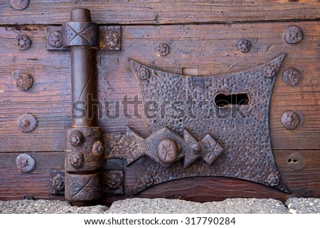 castle lock spain knocker lanzarote abstract door wood in the red brown  - stock photo