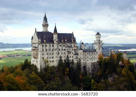Castle Neuschwanstein in the Bavarian Alps overlooking the town of Fussen, Germany - stock photo