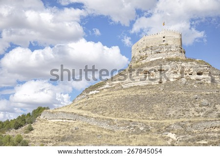 Castle of Curiel de Duero, fortified building located on a rocky hill in the province of Valladolid, Castile and Leon, Spain. - stock photo