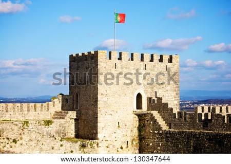 Castle of Montemor-o-Velho, Coimbra, Portugal with a Portuguese flag in a tower - stock photo