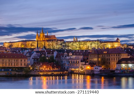 Castle of Prague (Czech Republic)and Vltava River in the sunset - stock photo