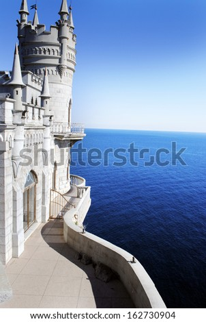 Castle on the cliff by the sea - stock photo