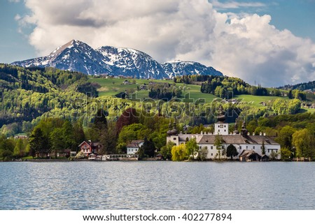 Castle Ort And Traunsee With Alps Mountain Range In The Background - Gmunden, Upper Austria, Austria, Europe - stock photo