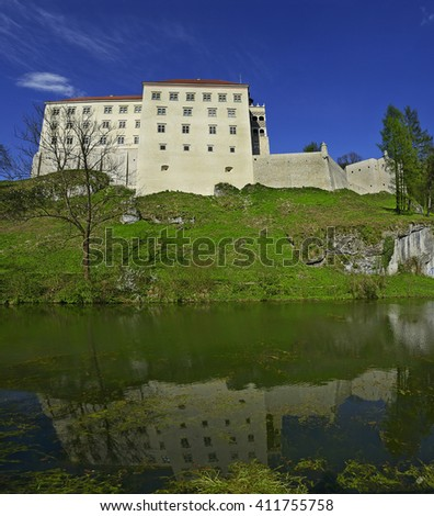 Castle Pieskova Skala (Little Dog's Rock), located a limestone cliff in valley of river Pradnik, best known Renaissance castle. Ojcow National Park near Krakow in Poland, Eagles' Nests Trail - stock photo