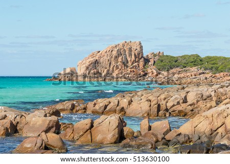Castle Rock, near Dunsborough in Western Australia, is a massive chunk of orange granite standing tall at the end of beautiful Castle Bay.
