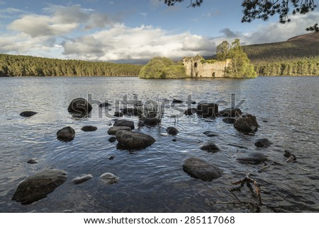 Castle Ruin on Loch an Eilein in the Cairngorms. - stock photo