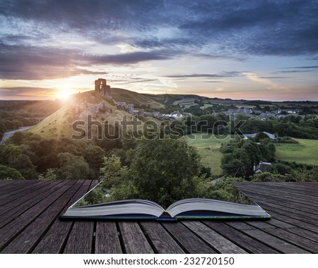 Castle ruins landscape at sunrise with sunburst behind castle conceptual book image - stock photo