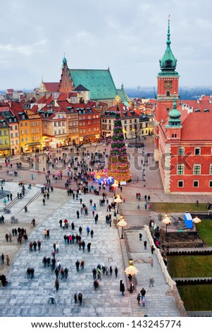Castle Square in the Old Town of Warsaw in Poland, illuminated at evening during Christmas time. - stock photo