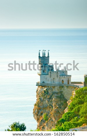 "Castle ""Swallow's Nest"" on a steep cliff by the sea - stock photo"
