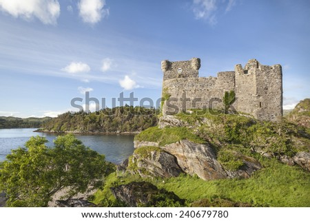 Castle Tioram on Loch Moidart in Scotland. - stock photo