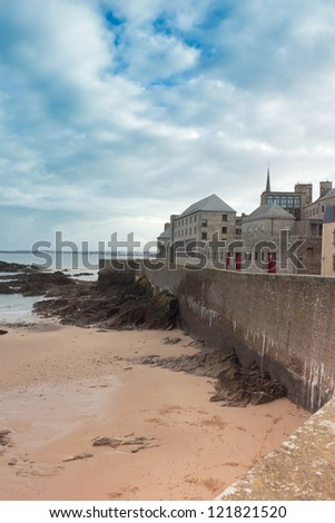 castle walls of Saint Malo, France, over sea - stock photo