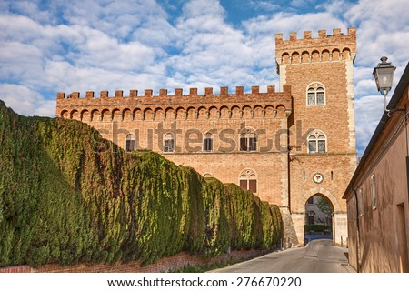 castle with tower and city gate of Bolgheri, the village made famous by a poem by Carducci, in Tuscany, Italy