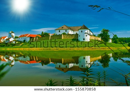 castle with water reflection - stock photo