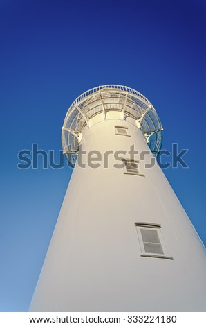 Castlepoint lighthouse from below. New Zealand.  - stock photo