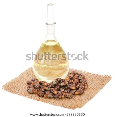 Castor oil with beans on sack over white background - stock photo