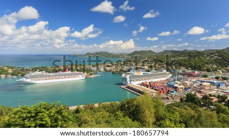 CASTRIES, ST LUCIA - NOVEMBER 7: Cruise ships Carnival Valor and P&O Ventura docked in Castries on November 7, 2013. The sheltered harbour offers a preferred destination for cruise ships. - stock photo