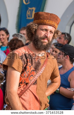 CASTRO MARIM, PORTUGAL - AUGUST 30: View of people, characters, mood, colors and street performers at the popular medieval fair held in Castro Marim village, Portugal on august.