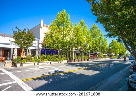 Castro Street in downtown Mountain View, California, USA.  Morning sunshine. - stock photo