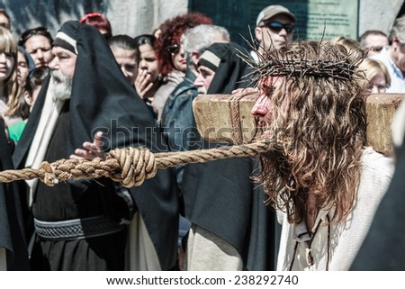 CASTRO URDIALES - SPAIN - APRIL 18: A local actor portrays Jesus of Nazareth in the living passion of Castro Urdiales celebrated in Castro Urdiales on April 18, 21014 - stock photo
