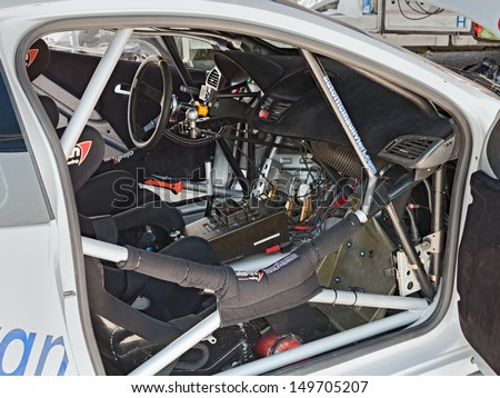 "CASTROCARO, FC,  ITALY - JULY 27: interior of a racing car, with roll cage, tuned controls and dashboard at ""Rally della Romagna 2013"", on July 27, 2013 in Castrocaro, FC, Italy"