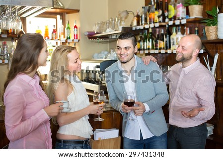 Casual acquaintance of happy smiling young adults at bar. Selective focus  - stock photo