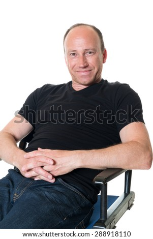 Casual adult man in black shirt. Studio shot over white. - stock photo