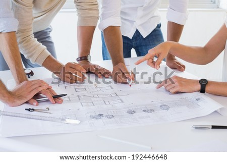 Casual architecture team working together in the office