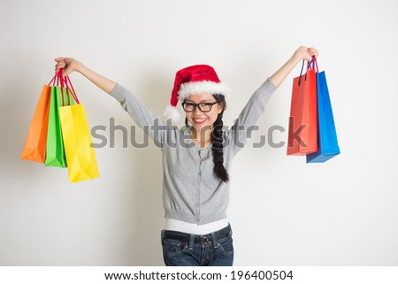 casual asian chinese with christmas gifts on white background - stock photo