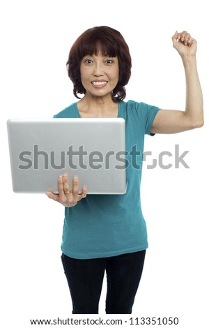 Casual asian girl holding the laptop in one arm with other one raised. All on white background