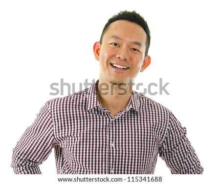 Casual Asian man hand on waist standing over white background. - stock photo