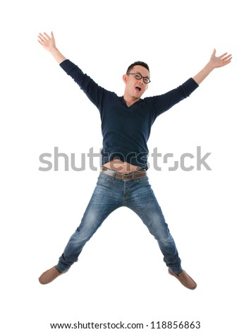 casual asian man jumping in joy