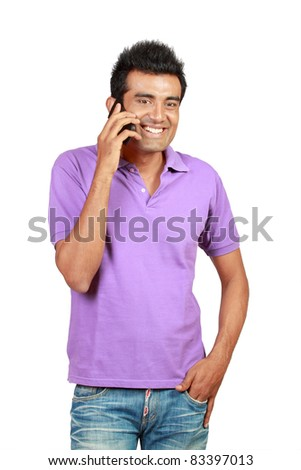 Casual asian man smiling using a mobile phone as a mode of communication - stock photo