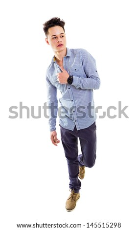 Casual attractive young man with a hand on the chest grabbing his shirt, leg lift up, full lenght, isolated on white. - stock photo