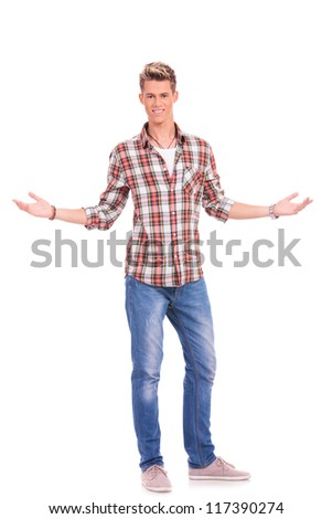 casual awesome young man welcoming with a smile on his face, on white background - stock photo