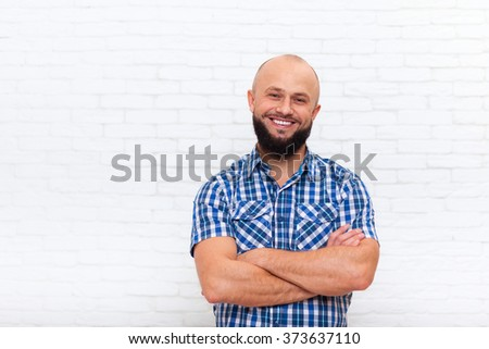 Casual Bearded Business Man Smiling Folded Hands Office Over White Brick Wall - stock photo