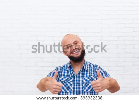 Casual Bearded Man Thumb Up Hand Gesture Smiling Over White Brick Wall - stock photo