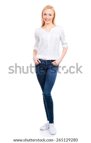 Casual beauty. Full length of beautiful young women looking at camera and smiling while standing against white background - stock photo