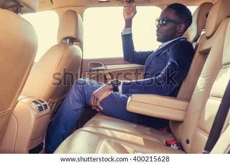 Casual black man in sunglasses. - stock photo