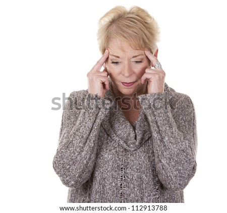 casual blond woman in her fifties having a headache - stock photo